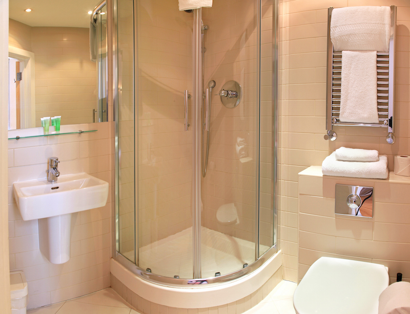 Shower and tub enclosures for small spaces for Bathroom door ideas for small spaces